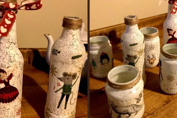Bottle and jam jars that have been decorated with festive designs using the decoupage technique