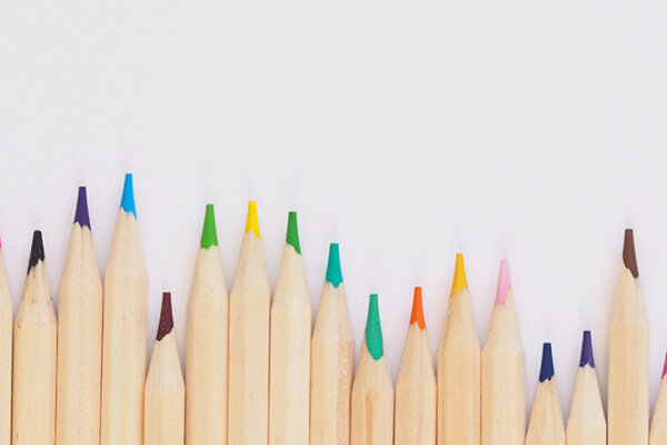 A row of brightly coloured pencils.