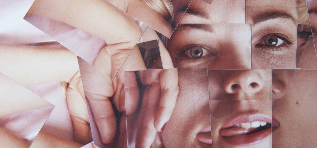Lots of separate photographs are creatively placed together to create a montage of a female face who is staring at the camera with her hand up by her face.