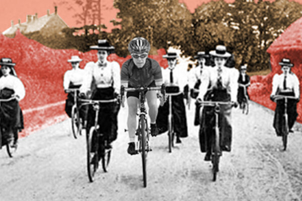 A woman in modern cycling gear leads a pack of other woman cyclists, who are in old fashioned clothing and bonnets. Their surroundings is British countryside which has a red filter on it.