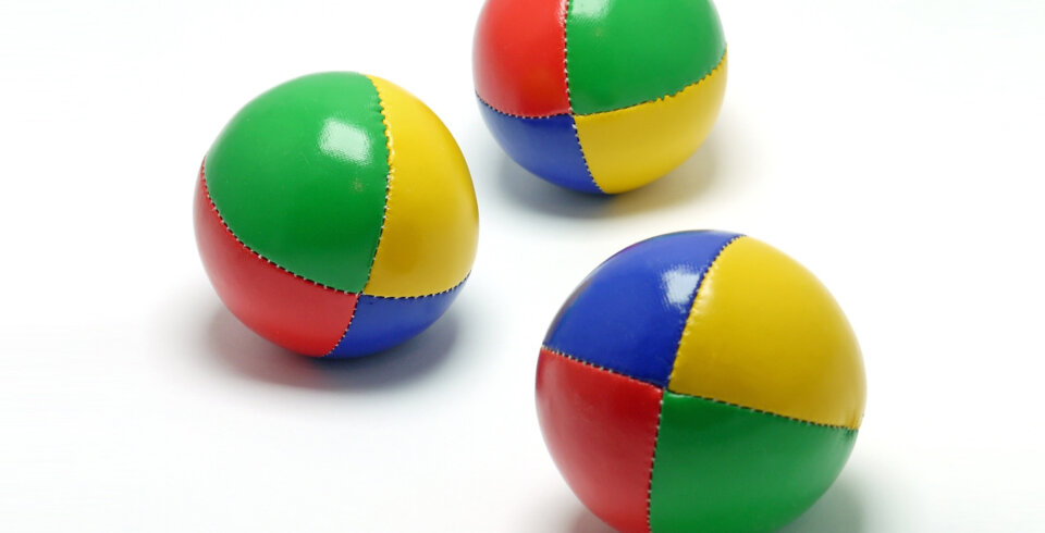 Three juggling balls on a white background
