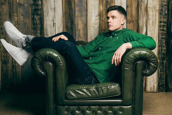 A picture of a man sitting on a green chair