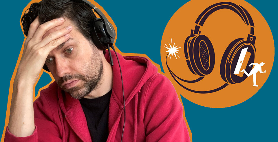 A picture of a man in read jacket wearing black headphones.